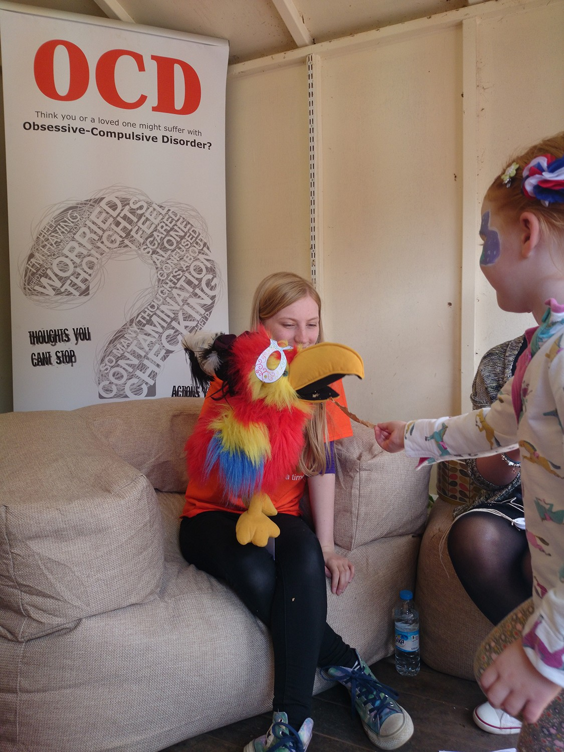 An OCD-UK volunteer working with a young person during an OCD awareness campaign in the East Midlands.